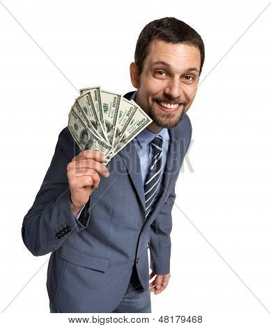 Successful businessman showing money - isolated over a white background