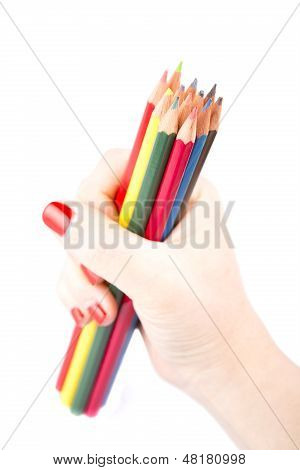 Hand Holding Colored Pencils Isolated