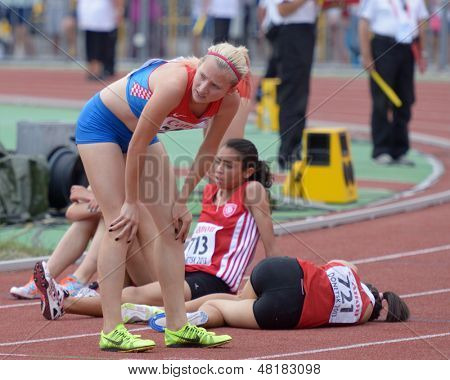 DONETSK, UKRAINE - JULY 14: Girls after finish in the final of 2000 metres steeplechase during 8th IAAF World Youth Championships in Donetsk, Ukraine on July 14, 2013