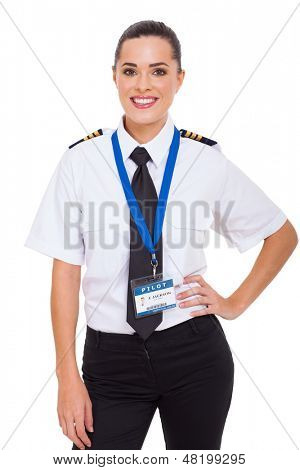 beautiful young female airline co-pilot isolated on white