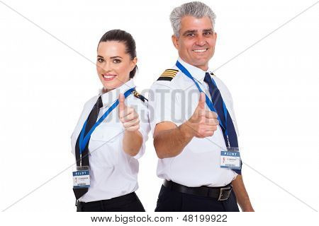 cheerful airline pilots giving thumbs up over white background