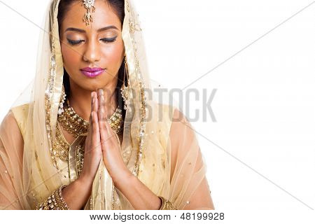 beautiful indian woman praying with eyes closed on white background