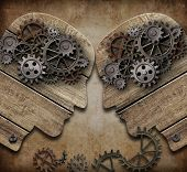two wooden heads with gears coming into collision concept poster