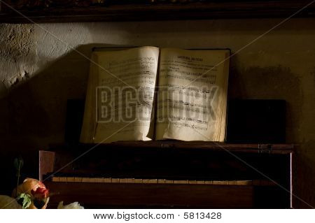 A Old Music Sheet In Antique Piano