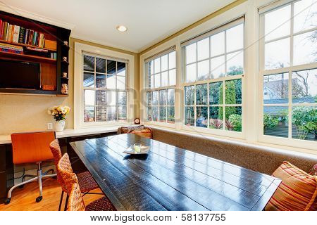 Old Style Dining Room With Wood Dining Table Set And Wicker Chairs