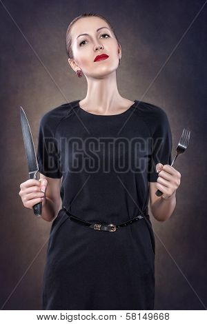 Girl With Red Lips With A Fork And Knife.