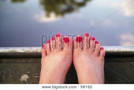 Feet In A Boat
