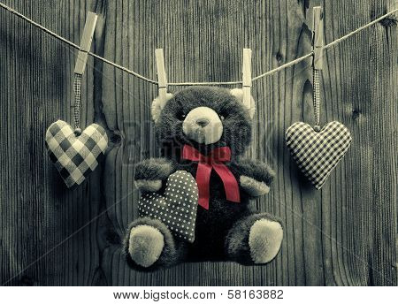 Valentine's Day wallpaper - Teddy Bear hanging with textile hearts