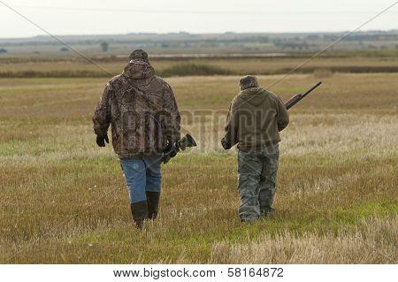 Hunters in a field