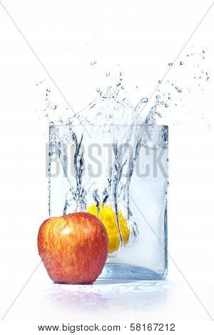 Apple And Lemon In Water And Splashes