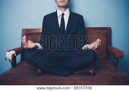 Businessman Is Meditating On Sofa