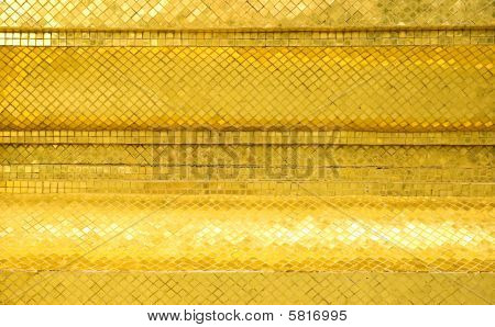 Shimmering golden mosaic wall of Thai Temple poster