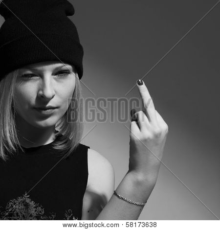 Angry Young Woman Making Obscene Hand Gesture By Showing Middle Finger