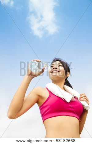 Asian Woman Drinking Water After Fitness Exercise