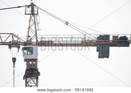 Empty Crane In A Construction Site Under The Bright Sky