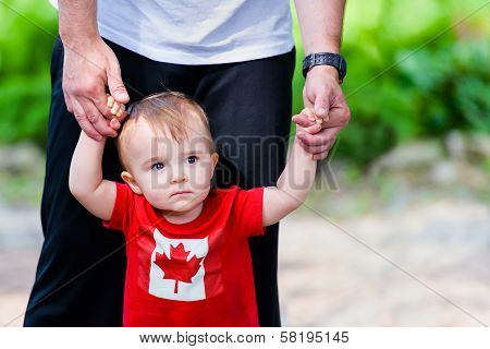 Little Boy In Maple Leaf Shirt