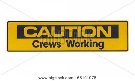 Weathered caution crews working sign isolated.