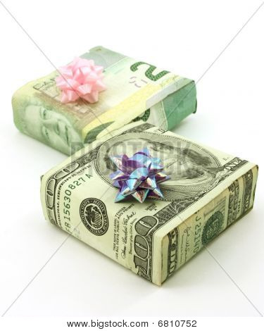 Dollars wrapped around two gifts with bows