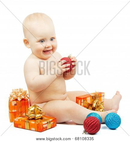 Rapt child holds red christmas ball, festive boxes