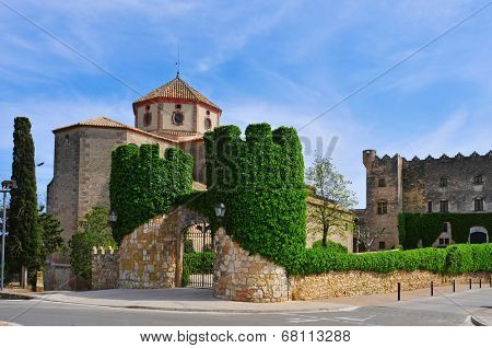 a view of Sant Marti Church and Altafulla Castle in Altafulla, Spain