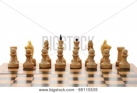 Chessmen On Wooden Chessboard