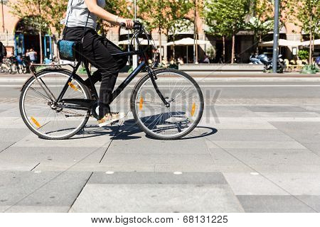 Bicycle In City Traffic