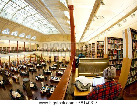 MELBOURNE, AUSTRALIA - July 3, 2014: Redmond Barry reading room at the State Library of Victoria in Melbourne.   It is the central library of the state of Victoria, Australia.