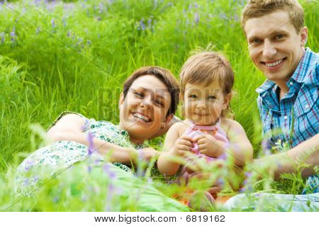 Happy Family In Grass