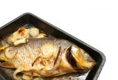 Closeup of grilled carp fish on the cook griddle poster
