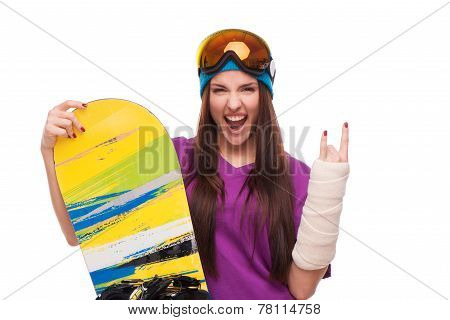 Extreme woman with broken arm and snowboard
