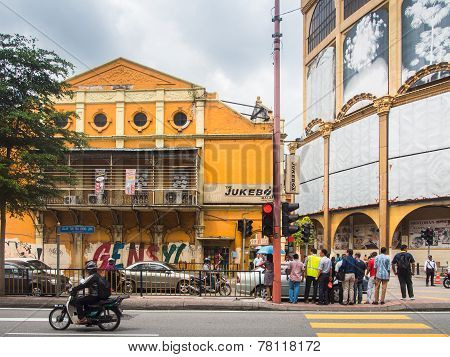 People Crossing Street Over Grecian-spanish Style Buildings Background