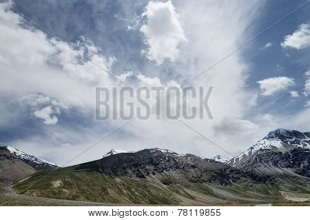 Snowcapped Mountains Under Deep Blue Sky And Beautiful Clouds