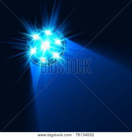 Bright blue flashlight light in darkness