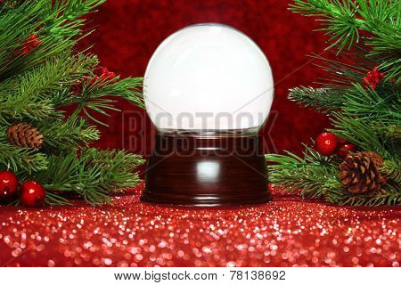 Christmas tree branches with empty snowglobe