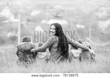 Happy Mother With Small Children Walking