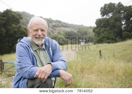 Smiling Old Man In Nature