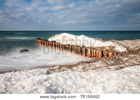 Winter on the Baltic Sea coast with groyne. poster
