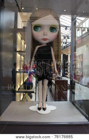 Bottega veneta window with big doll