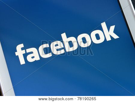 ZAPORIZHZHYA, UKRAINE - NOVEMBER 07, 2014: White Smart Phone with Facebook Social Network on the Screen