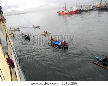 People in Outrigger Canoes in the Philippines
