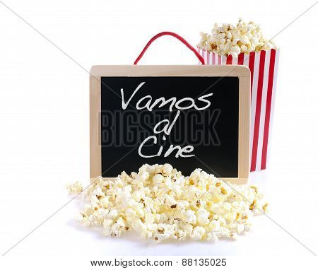 Popcorn and blackboard on a wooden table
