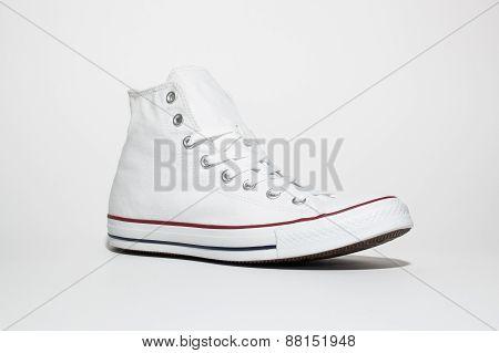 Single white sneaker