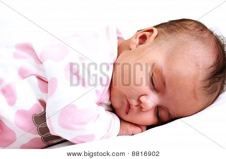 close-up of newborn baby peaceful and asleep