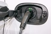 Charging an electric hybrid car close up. poster
