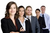 an attractive young woman heads up a young business team of professionals (shallow depth of field) poster