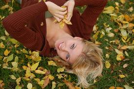 Woman Throwing Leaves