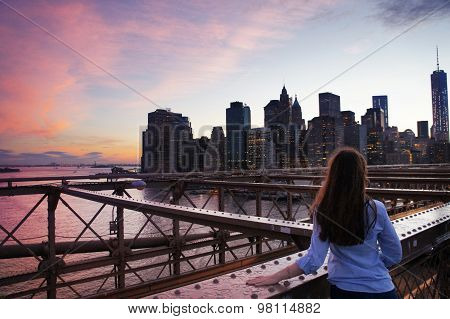 Girl Look At Manhattan Buildings From Brooklin Bridge At Dawn