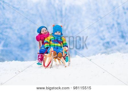 Kids Riding Sleigh In Winter Park