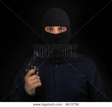 Masked thief with gun