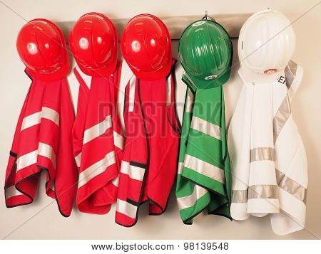 Wall hanger with vest and helmets for a emergency warden team